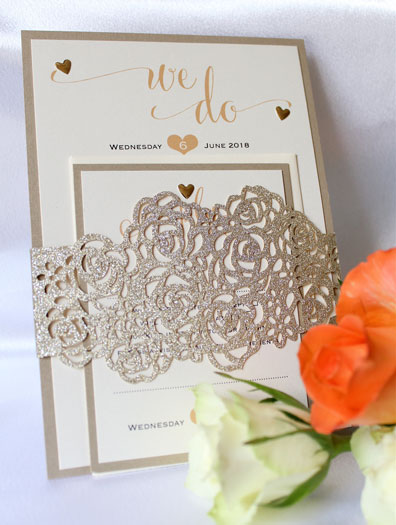 Bundles Glitter Roses flat wedding invitaton and reply card wrapped in laser cut gold glitter belly band. Ivory metallic card mounted on gold metallic card