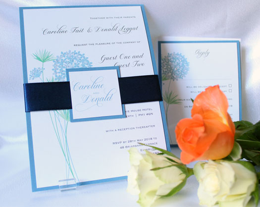 Bundles Hydrangea flat wedding invitation and matching rsvp card. White pearlescent card printed with blue and lilac hydrangea illustration mounted on smokey blue pearlescent card