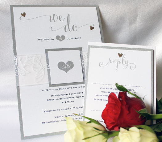 Bundles Silver Chiffon flat wedding invitation with matching rsvp card and envelope wrapped with white fflower printed chiffon and tag with bride and groom initials