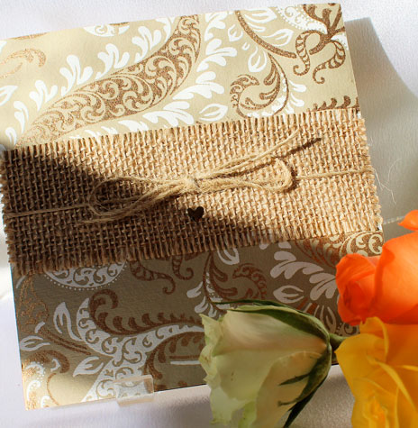 Rustic Gold Wedding invitation with handmade gold and white patterned paper. hessian and twine and gold heart