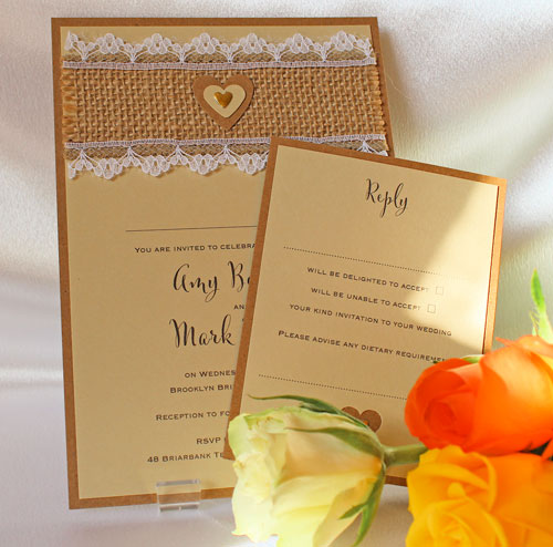 Rustic Hessian Lace wedding invitation with hesiian strip edged with white lace and finished with a layered heart
