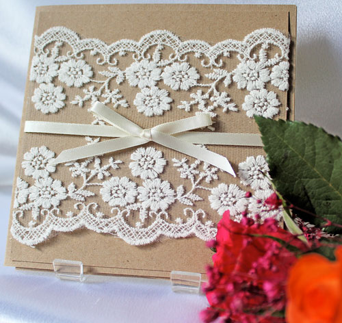 Rustic Lace wedding invitation made from recycled card with wide flowery ivory lace and narrow ivory satin ribbon